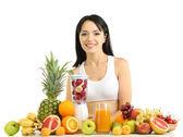 Girl with fresh fruits isolated on white — Stock Photo