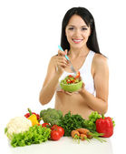 Girl with salad isolated on white — Stock Photo
