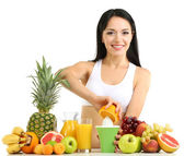 Girl with fresh fruits and juice isolated on white — Stock Photo
