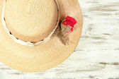 Beautiful summer hat on wooden background — Stok fotoğraf