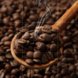 Stock Photo: Coffee beans in wooden spoon with smoke, close up