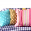 Colorful pillows on couch isolated on white — ストック写真
