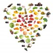 Heart made from various fruits and vegetables isolated on white — Stock Photo