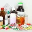 Medical bottles and pills on shelf — Stock Photo