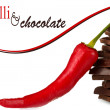 Dark chocolate with chili pepper isolated on white — Stock Photo #27316525