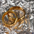 Stock Photo: Wedding rings on silver background
