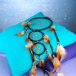 Stock Photo: Beautiful dream catcher and pillows on blue background
