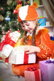 Little girl opens gift — Stock Photo