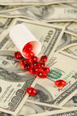 Pills and money close-up background — 图库照片