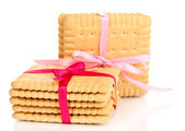 Sweet cookies tied with pink ribbons isolated on white — Stock Photo