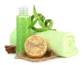 Bottiglia con scrub e sapone fatto a mano, isolato su bianco — Foto Stock