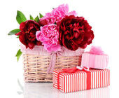 Beautiful peonies in wicker basket isolated on white — Stock Photo