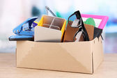 Personal property in carton on table in room — Stock Photo