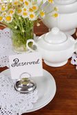 Table setting with chamomiles on wooden table — Stock Photo