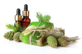 Hand-made soap and bottles of fir tree oil, isolated on white — Stock Photo
