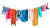 Laundry line with clothes isolated on white — Stock Photo