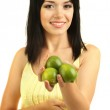 Girl with fresh limes isolated on white — Stock Photo