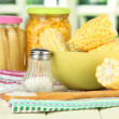 Canned corn, boiled corn in bowl, on wooden table, on bright background — Stock Photo #27372205