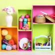 Colorful shelves of different colors with utensils on wall background — Foto Stock