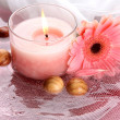 Beautiful pink candle with flower in water — Stock Photo #27373773