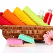 Colorful towels, cosmetics bottles and soap in basket, isolated on white — Stock Photo