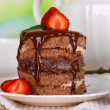Chocolate cake with strawberry on wooden table on natural background — Photo