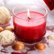 Beautiful red candle with flower petals in water — Stock Photo #27375337