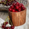 Sweet cherry in wooden basket on table close-up — Stock Photo #27379167