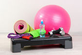 Different tools for fitness in room — Stock Photo