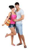 Vackert älskande par på sommarlovet isolerad på vit — Stockfoto