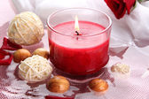 Beautiful red candle with flower petals in water — Stockfoto