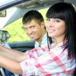 Beautiful young woman taking driving lesson — Stock Photo #27412901