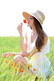 Portrait of beautiful young woman with poppies in the field — Stock Photo