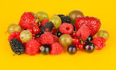 Ripe berries on yellow background — Stock Photo