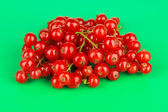 Redcurrants on green background — Stock Photo