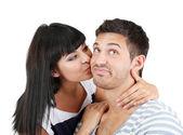 Beautiful loving couple kissing isolated on white — Stock Photo