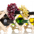 Bottles of wine placed on wooden stand isolated on white — Stock Photo
