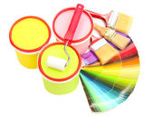 Set for painting: paint pots, brushes, paint-roller, palette of colors isolated on white — Stock Photo