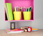 Colorful pencils in pails on shelf on beige background — ストック写真