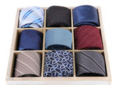 Neckties in wooden box isolated on white — Foto Stock