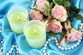 Candles on blue fabric close-up — Stock fotografie