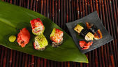 Tasty Maki sushi - Roll on bamboo mat — Stock Photo