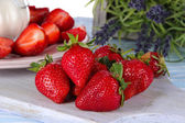 Strawberries on board cutting close-up — Stock Photo