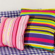 Colorful pillows on couch isolated on white — Stock Photo #27481987