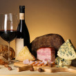 Постер, плакат: Exquisite still life of wine cheese and meat products