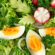 Fresh mixed salad with eggs, salad leaves and other vegetables, close up — Stock Photo