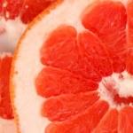 Grapefruit slices background — Stock Photo