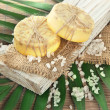 Hand-made soap and sea salt  on grey bamboo mat — Stok fotoğraf