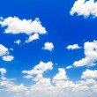 Blue sky background with clouds — Stock Photo #27485185