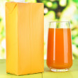 Juice pack on table on bright background — Stock Photo #27488535